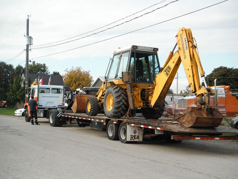 Flatbed & Backhoe